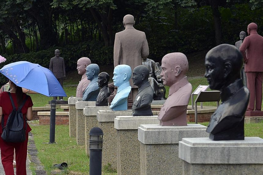 Statues of late nationalist leader Chiang Kai-shek at a park in Taoyuan, northern Taiwan. Tributes to him will be removed after lawmakers voted for the mandatory axing of symbols of its authoritarian past.