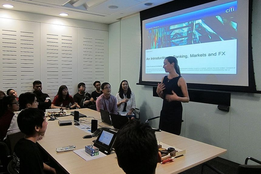 "Ms Joyce Skidell, Citi Singapore's lead for its ""e for Education"" campaign, speaking to students from ITE College East about the world of markets and forex trading. The campaign has raised US$6.25 million (S$8.4 million) this year and around US$22.5"