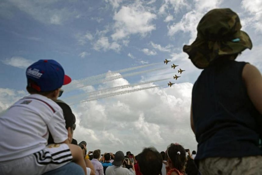 Visitos to the Singapore Airshow watching a display by South Korea's Black Eagles on Feb 21, 2016.
