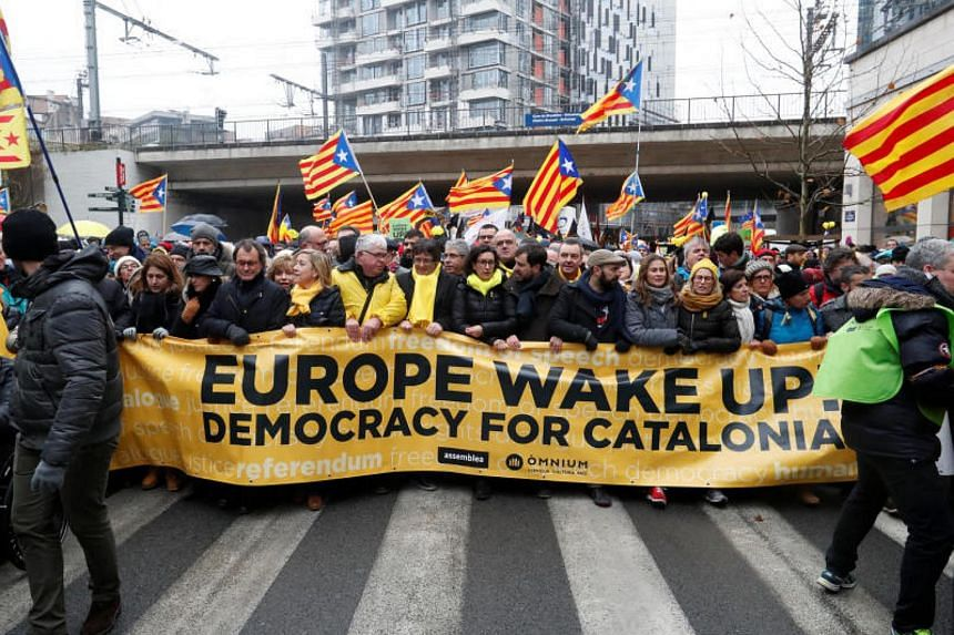 Ousted Catalan leader Carles Puigdemont (seventh from left) takes part in a pro-independence rally for Catalonia in Brussels on Dec 7, 2017.