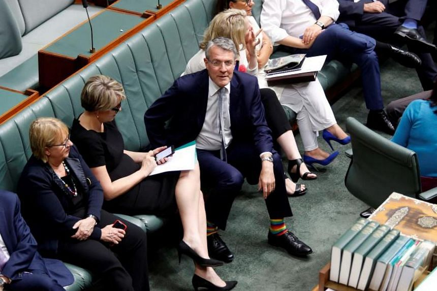 Australian Labour Party member, Shadow Attorney-General Mark Dreyfus (centre), wears rainbow socks in support of same-sex marriage at the House of Representatives in Canberra on Dec 7, 2017, ahead of the parliamentary vote on marriage equality.