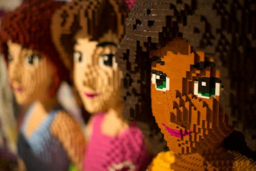 Giant toy brick models from the Lego Friends range sit on display inside the new Hamleys Plc toy store on its opening day in Moscow, Russia, on March 31, 2015.