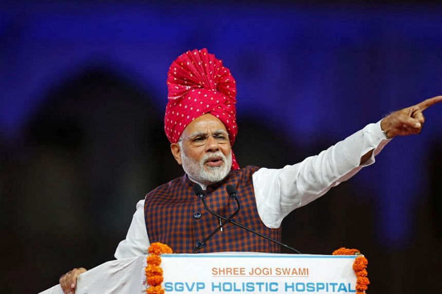 Indian PM Narendra Modi addressing his supporters at an election campaign meeting in Ahmedabad on Dec 3, 2017.