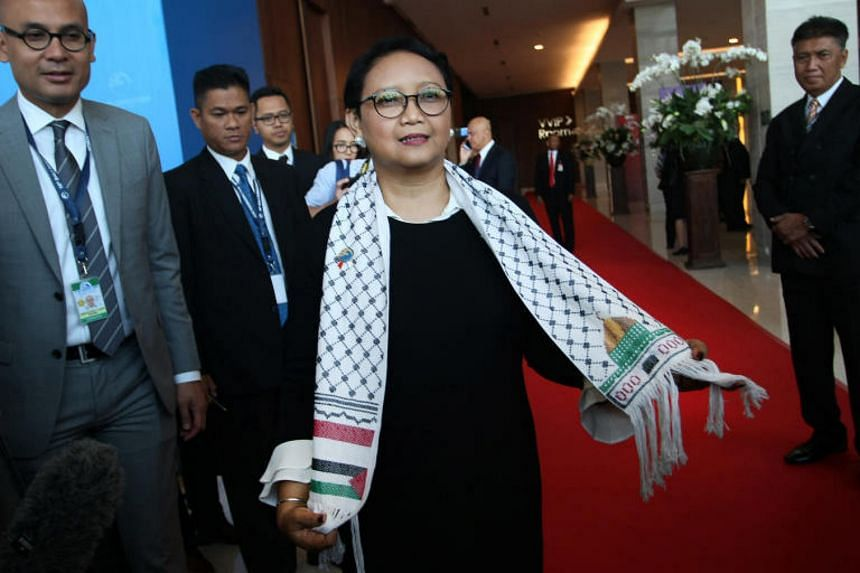 Indonesia's Foreign Minister Retno Marsudi wears a scarf adorned with the Palestinian and Indonesian flags, on the sidelines of the 10th Bali Democracy Forum on Dec 7, 2017.
