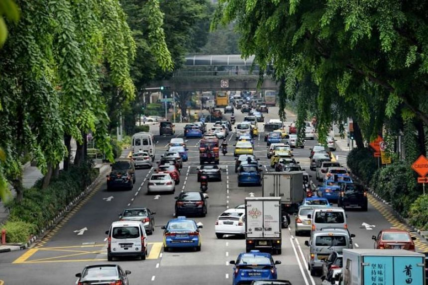 Motorists enter the financial district area in Singapore on Oct 24, 2017.