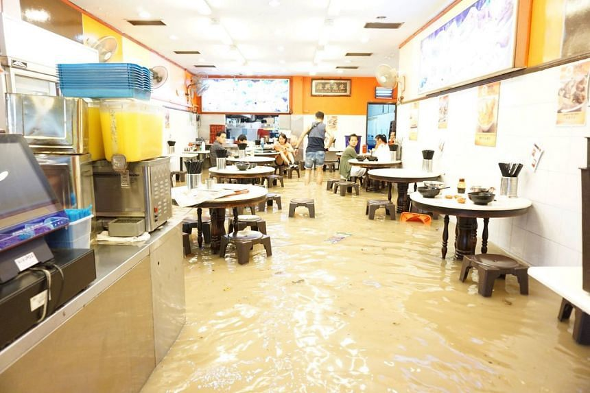 Flooding at Ming Fa Fishball along Upper Thomson Road on Dec 24, 2016. Japanese firm Sato Kogyo, which was responsible for the flooding, was hit with a $14,000 fine on Dec 7, 2017.
