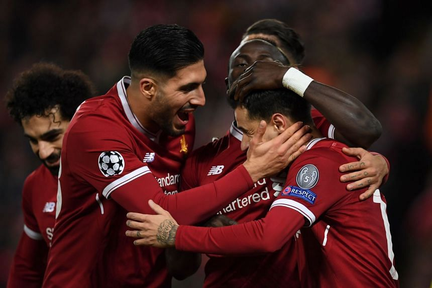 Liverpool's Brazilian midfielder Philippe Coutinho (right) celebrates scoring their fifth goal and completing his hat-trick.