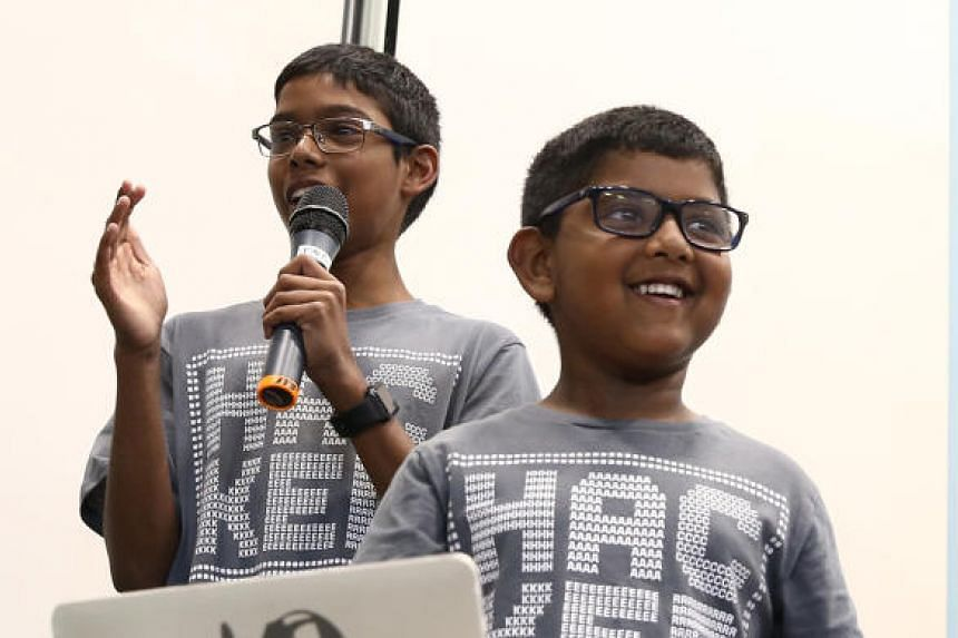 Reuben Paul, 11 (left) is joined by his five-year-old brother Ittai Aidan Paul, who is making his debut as a cyber security speaker.