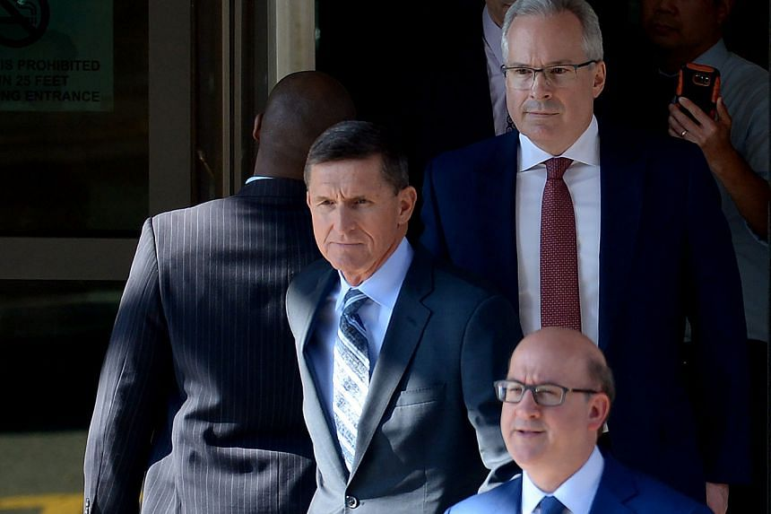 Michael Flynn leaving court surrounded by members of his legal team.