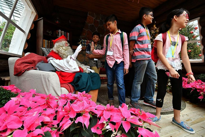 Beneficiaries from Hope Centre (Singapore) meeting Santa Claus at Gardens by the Bay on Dec 7, 2017.