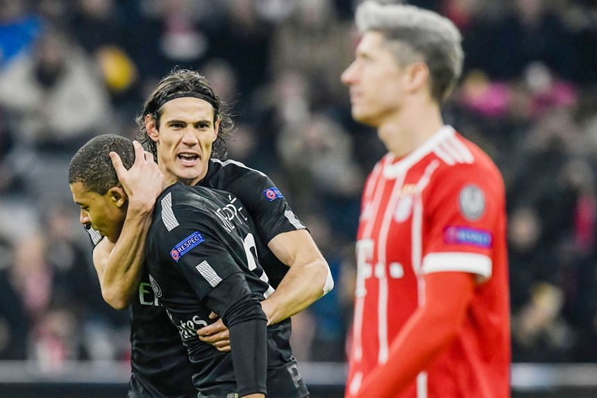 PSG's Edinson Cavani congratulating team-mate Kylian Mbappe after the Frenchman pulled a goal back against Bayern Munich. The Group B winners need to play better in the last 16.