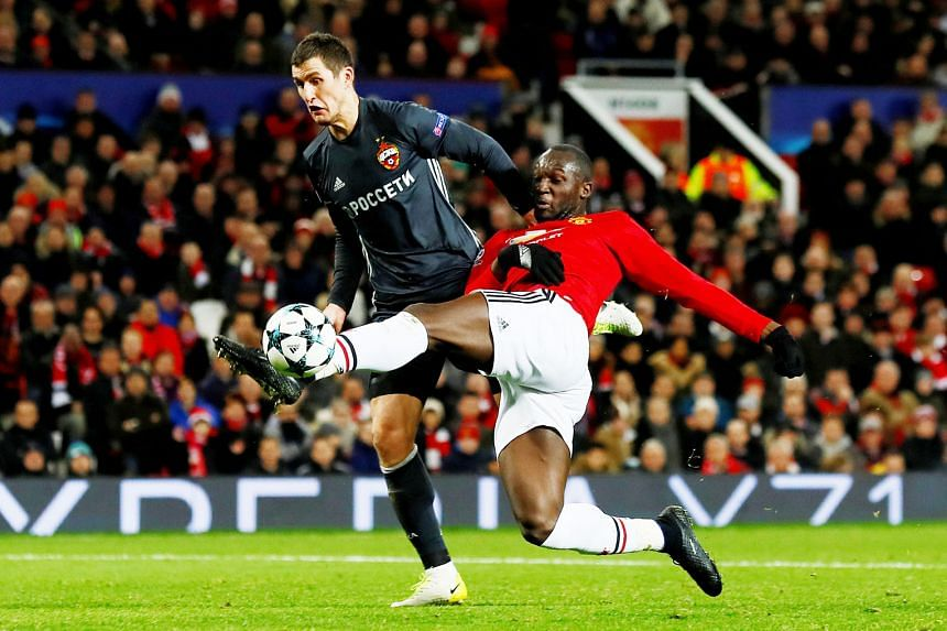 Romelu Lukaku holding off Viktor Vasin to volley in Manchester United's equaliser against CSKA Moscow from Paul Pogba's pass. Marcus Rashford scored the winner for United to enter the Champions League last 16 as group winners.