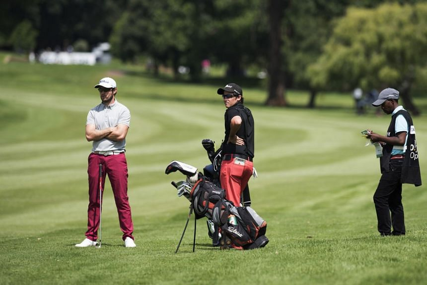 Kalle Samooja of Finland and Matias Calderon of Chile waiting to play their shots on the 17th fairway.