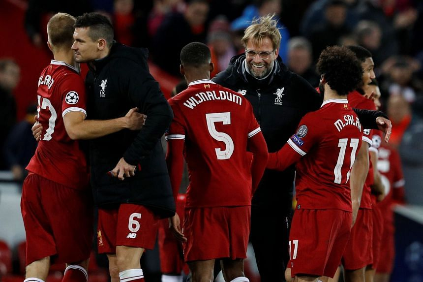 Klopp and his players celebrate after their 7-0 Champions League demolition of Spartak Moscow.