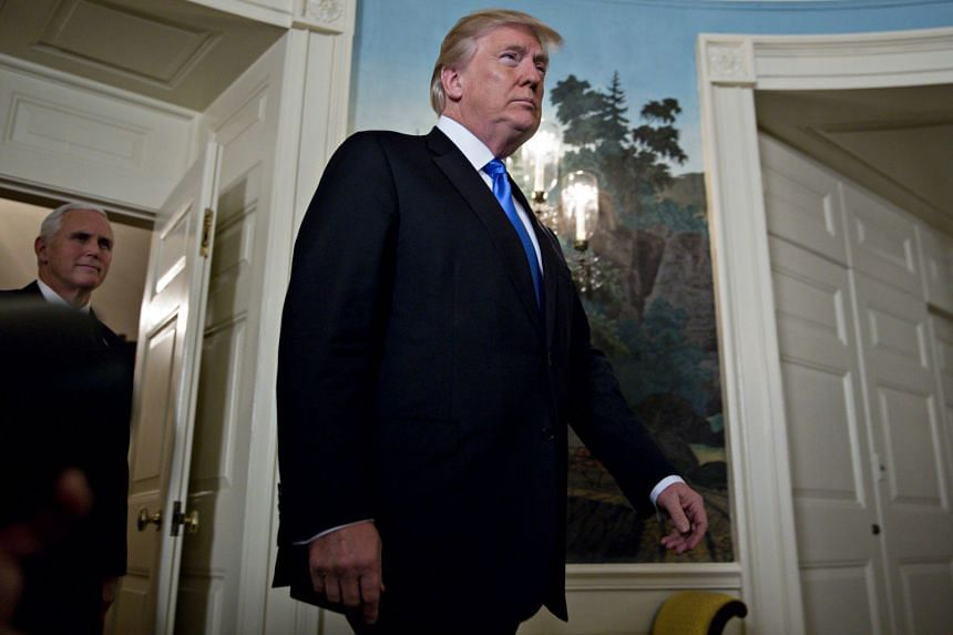 Trump arriving to make a statement on Jerusalem in the Diplomatic Room of the White House.