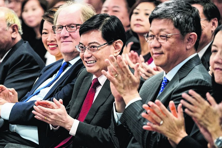 Finance Minister Heng Swee Keat (centre) seated between NTU President Bertil Andersson and Mr Robin Hu, Head, Sustainability and Stewardship Group, Temasek. Seen next to Mr Andersson is Ms Foo Mee Har, CEO of the Wealth Management Institute at NTU, w