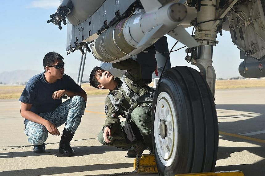 A GBU-31, which is a GPS-guided precision munition that can accurately target and destroy large or heavily fortified structures, is ready to be loaded onto an F-15SG fighter jet.