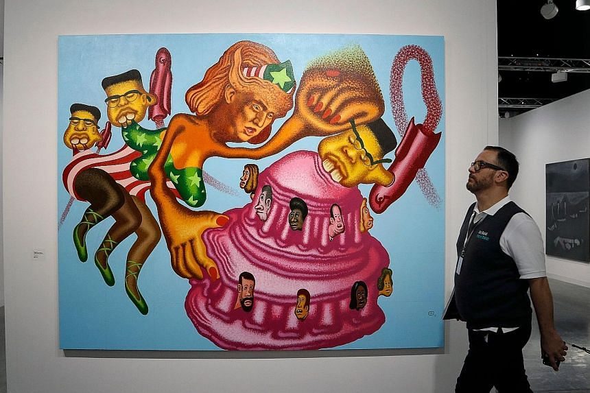 """A painting, entitled """"President Trump becomes a Wonder Woman, unifies the country and fights Rocket Man"""", was a star attraction at Art Basel in Miami Beach which opened yesterday. The parody piece by Peter Saul shows the US President in the iconic ga"""