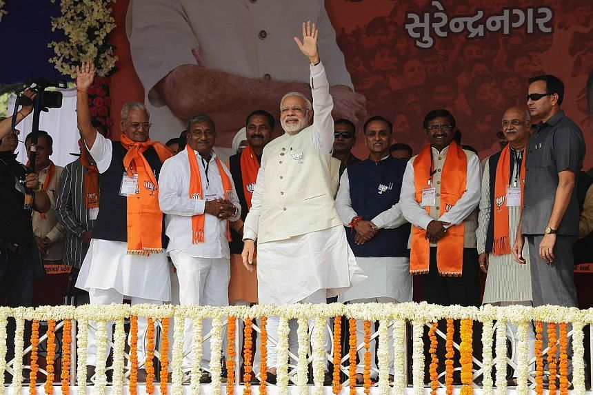 Indian Prime Minister Narendra Modi before the start of a rally on Sunday in Surendranagar, Gujarat. He hopes to fight off a stiff challenge from opposition Congress' Mr Rahul Gandhi.