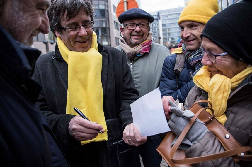 Carles Puigdemont (centre) attends a pro-independence demonstration on Dec 7, 2017 in Brussels.