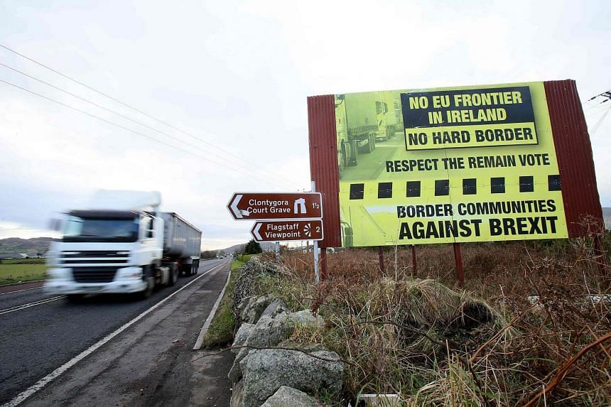 Traffic crosses the border into Northern Ireland from the Irish Republic alongside a Brexit Border poster on the Dublin road Co Armagh border.