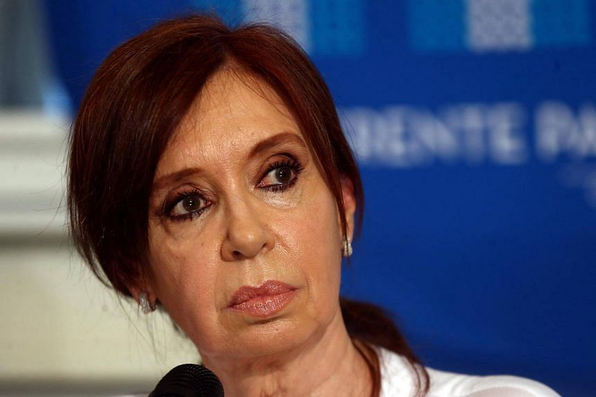 Former Argentine President Cristina Fernandez de Kirchner looks at journalists during a news conference at the Congress in Buenos Aires, on Dec 7.
