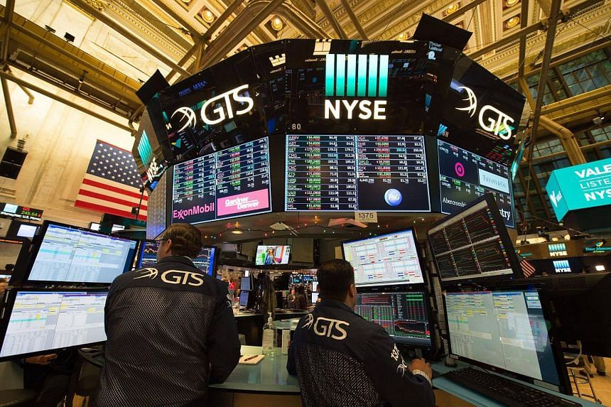 Traders work on the floor at the closing bell of the Dow Industrial Average at the New York Stock Exchange, on Dec 6, 2017.