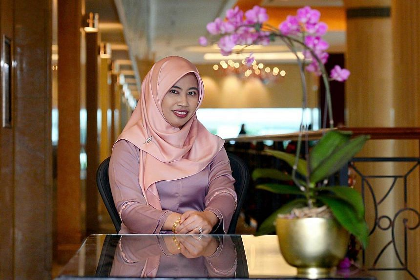 """Madam Rasidah Rahim, principal of Queenstown Secondary School, said """"teaching is very nurturing, which may come more naturally to women""""."""