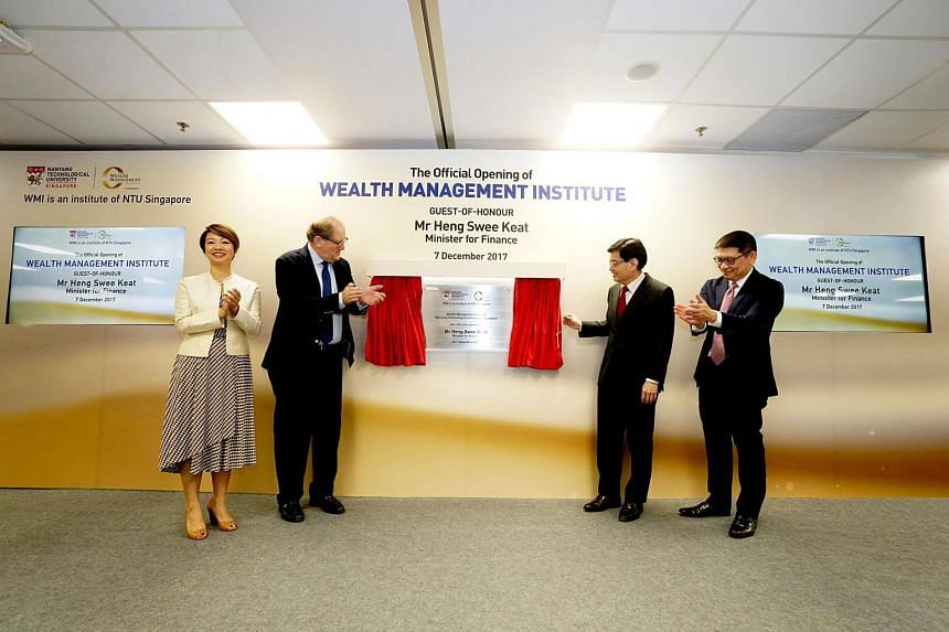 Finance Minister Heng Swee Keat (third from left) officially opens the new premises of NTU's Wealth Management Institute. With him are (from left) CEO of NTU's Wealth Management Institute Foo Mee Har, NTU President Prof Bertil Andersson, and GIC CE