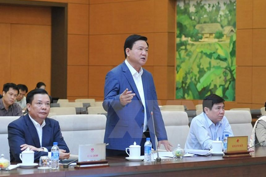 Former top Communist Party official Dinh La Thang (standing) is suspected of misconduct while he was chairman of the main state energy firm.