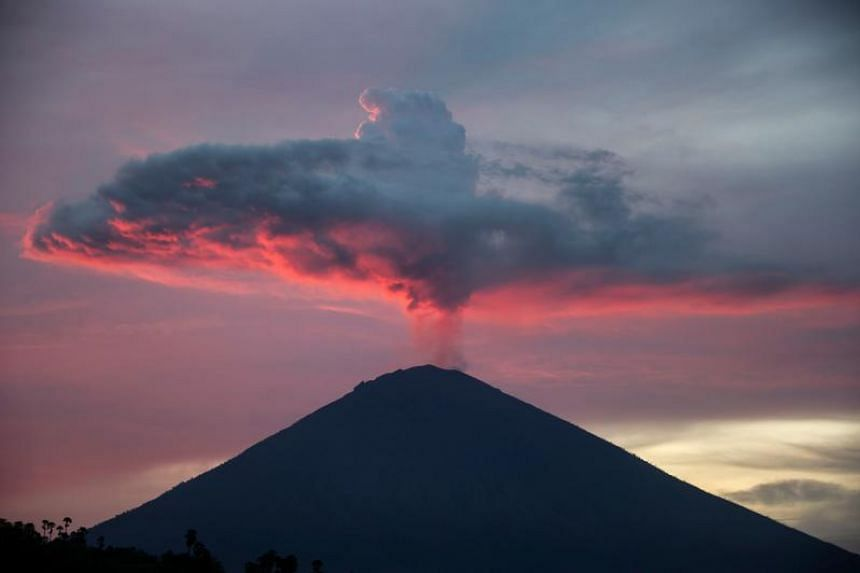 A view of Mount Agung from Amed beach in Karangasem on Indonesia's resort island of Bali on Nov 30, 2017.