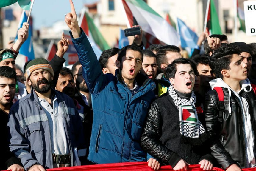 Demonstrators shout slogans during a protest against US President Donald Trump's recognition of Jerusalem as Israel's capital, in Istanbul, Turkey, December 8, 2017.