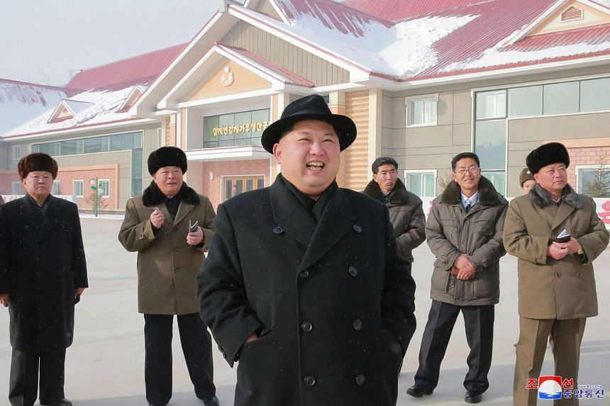 North Korean leader Kim Jong-Un (centre) inspecting a newly-built factory in a photo released on Dec 6, 2017.