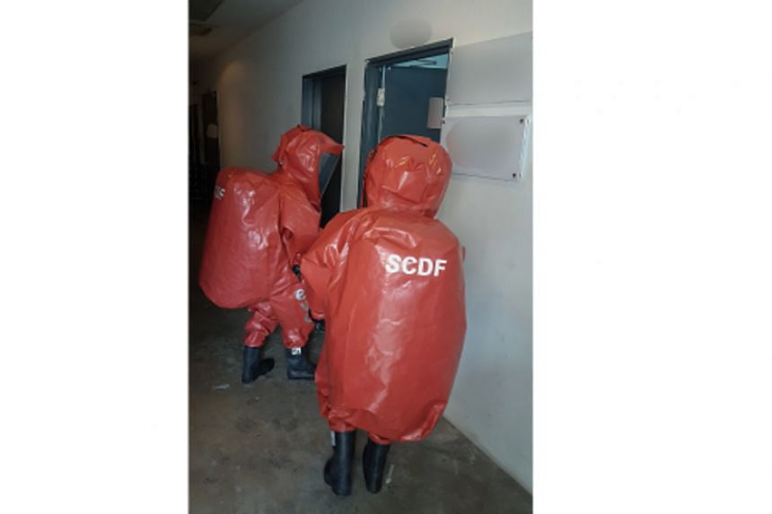 The Singapore Civil Defence Force's HazMat (Hazardous Materials) specialists entering to investigate a pungent smell detected in a unit in an industrial building in Yishun on Dec 6, 2017.