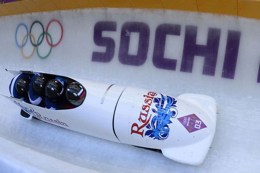 Russia's four-man bobsleigh team comprising pilot Alexander Zubkov, pushman Alexey Negodaylo, pushman Dmitry Trunenkov and brakeman Alexey Voevoda competing at the Sochi Games. The team have since been stripped by the IOC of their gold medals after T