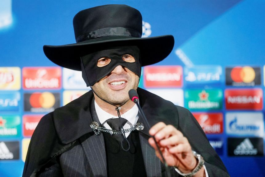 Shakhtar Donetsk coach Paulo Fonseca, dressed as Zorro, complete with mask, hat and cape, speaks to the media after his side ended Manchester City's unbeaten run with a 2-1 victory in the Champions League.
