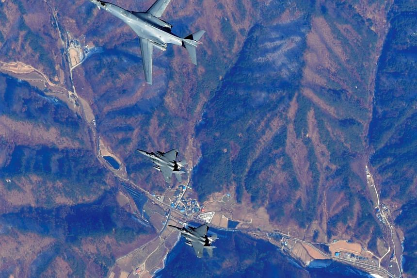 US Air Force B-1B Lancer bomber (centre) flying over South Korea with other US and South Korean fighter jets during a joint military drill in a photo released by the South Korean Defence Ministry on Wednesday.