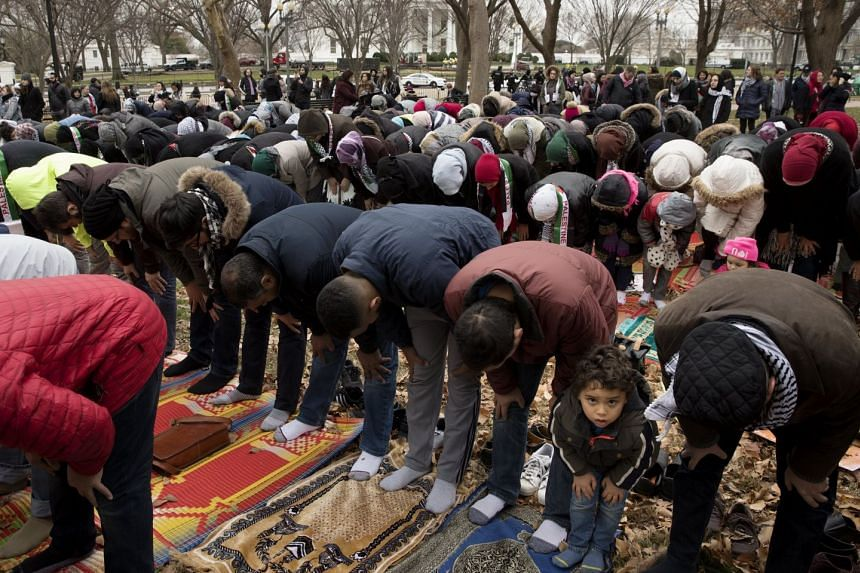 People pray in President's Park across the street from the White House.