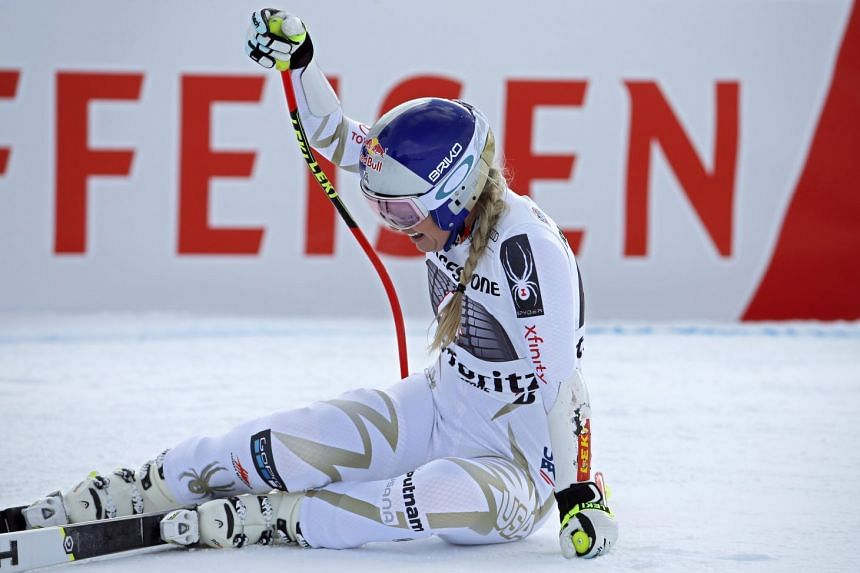 Lindsey Vonn, of the United States, grimacing in pain after crossing the finish line, during the women's Super-G race at the FIS Alpine Ski World Cup, in St. Moritz, Switzerland on Dec 9, 2017.