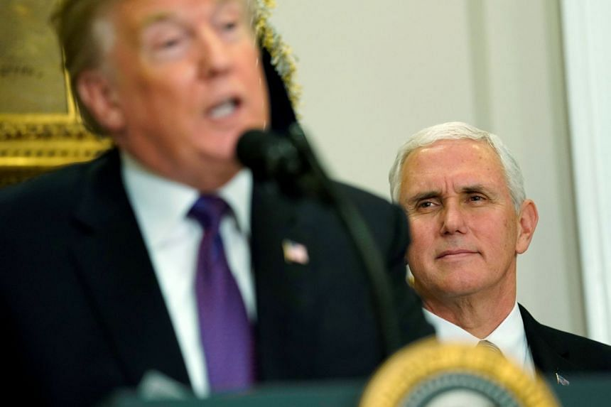 Pence watches US President Donald Trump speaking at the White House, Dec 7, 2017.
