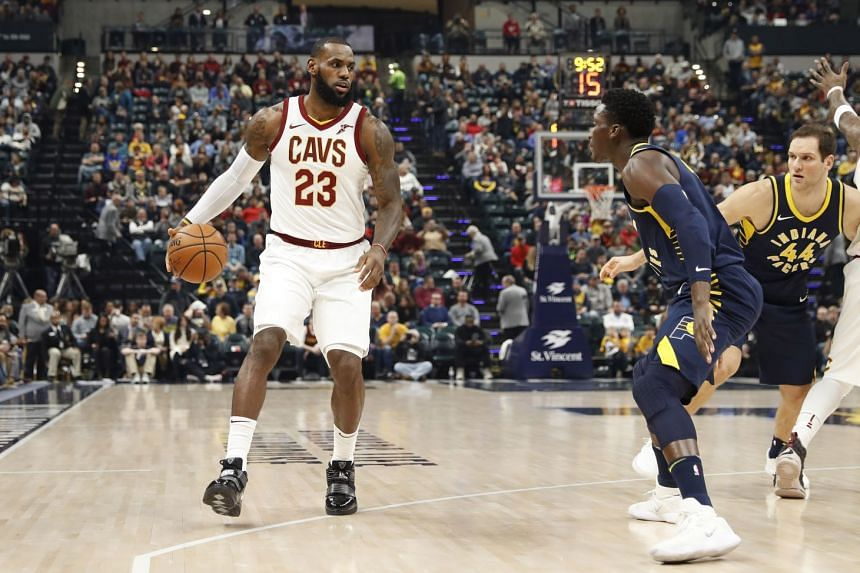 Cleveland Cavaliers forward LeBron James in possession as Indiana Pacers guard Victor Oladipo defends during the first quarter at Bankers Life Fieldhouse. Oladipo scored 33 points as his team ended the Cavs' 13-game winning run.