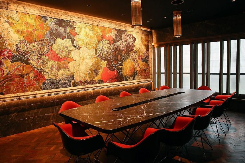 The reception table (above) is made from natural crystal from Madagascar. The Teapot Bar is decorated with 360 vintage teapots. A 6m-long pine log is turned into the bar counter at The Double. The feature wall in the private dining room is by Austral