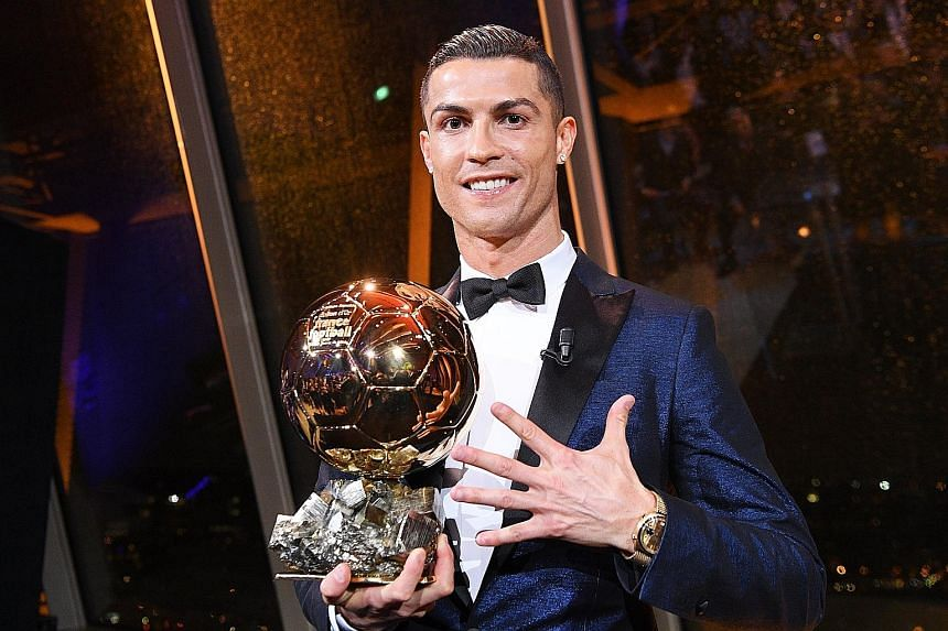 Portuguese striker Cristiano Ronaldo after receiving the 62nd Ballon d'Or award in Paris. He has had a lean spell this season in LaLiga with just two goals in 10 games but this week became the first player to score in all six Champions League group g