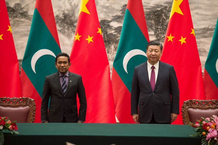 Maldives' President Abdulla Yameen stands with China's President Xi Jinping during a signing ceremony at the Great Hall of the People in Beijing.
