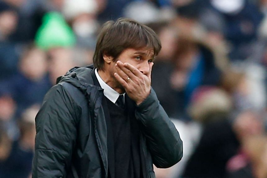 Chelsea's Antonio Conte gestures on the touchline during the match.