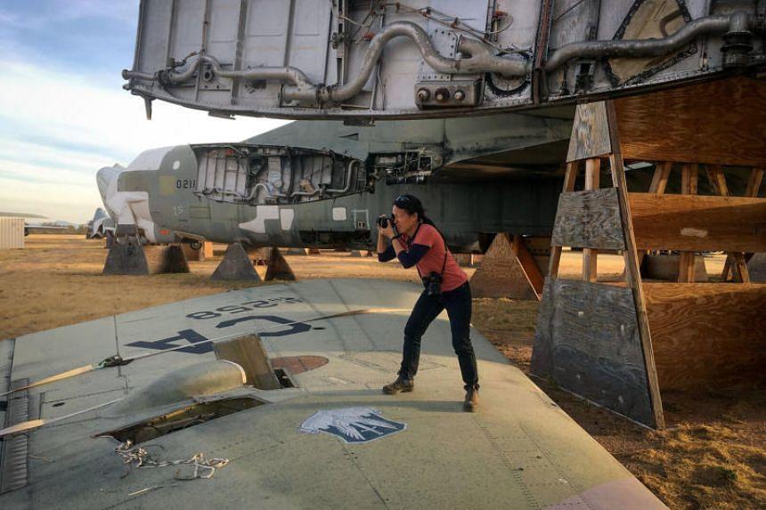 Sim Chi Yin photographs a decommissioned B52 Bomber at the Davis-Monthan Air Force Base Boneyard in Tucson, Arizona, on Nov 20, 2017.