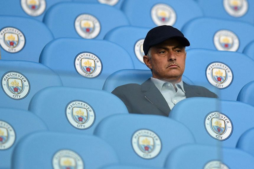 Mourinho in the Etihad Stadium stands before Manchester City played Everton in August 2017.