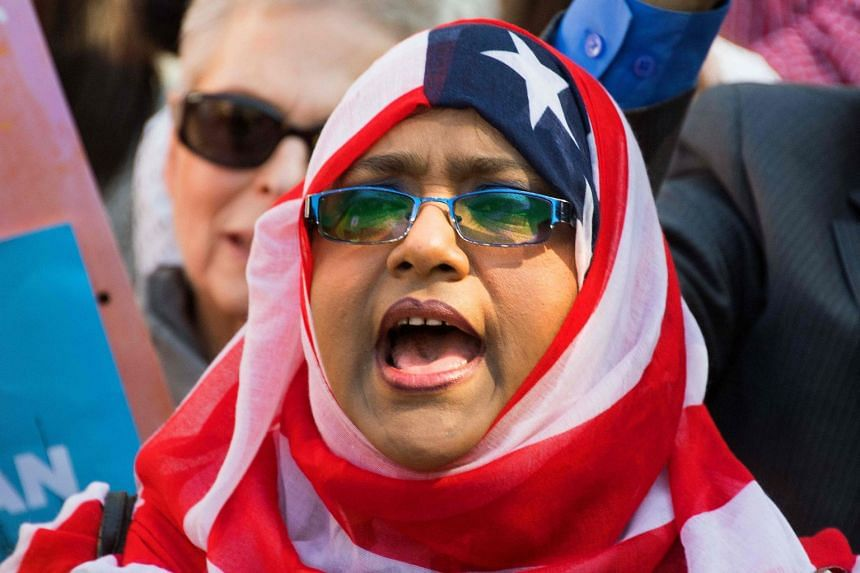 A demonstrator chanting during a #NoMuslimBanEver rally in Washington in October 2017.