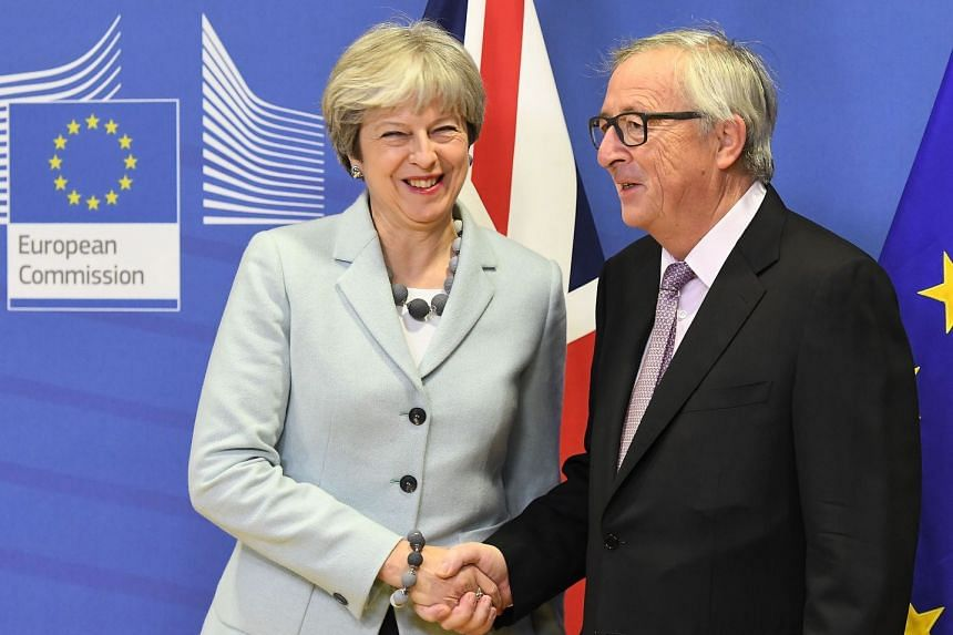 British Prime Minister Theresa May (left) and European Commission President Jean-Claude Juncker at the European Commission in Brussels, on Dec 8, 2017.