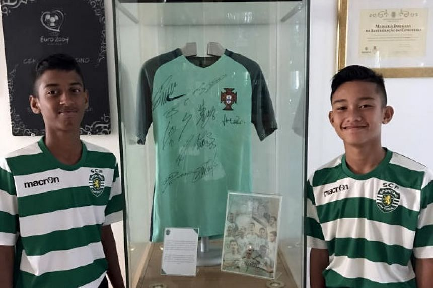 Singaporean teenagers Ajay Robson (left) and Muhammad Danial trained at the famed Sporting Lisbon academy that produced Cristiano Ronaldo.